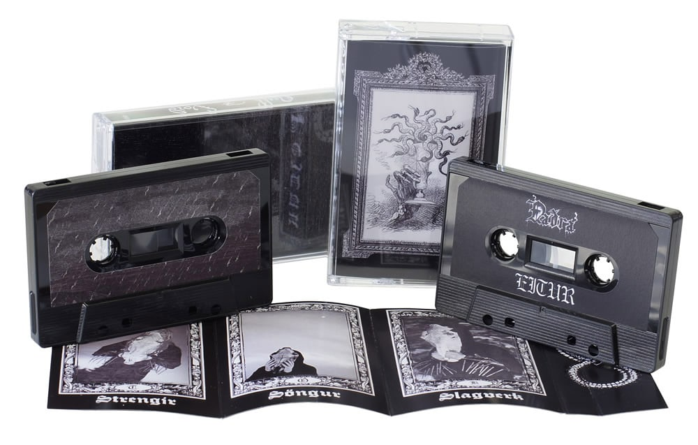 A set of two black cassettes in jewel cases with 8 page inserts