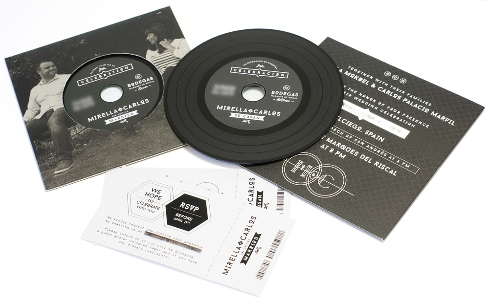 Record-style wedding wallets with black vinyl-style CDs and a matt laminate