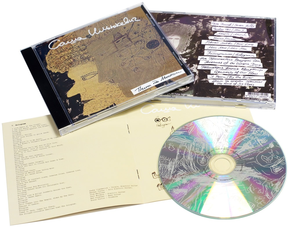 Jewel cases with 12 page booklets and a two colour silk screen print directly onto the silver disc surface