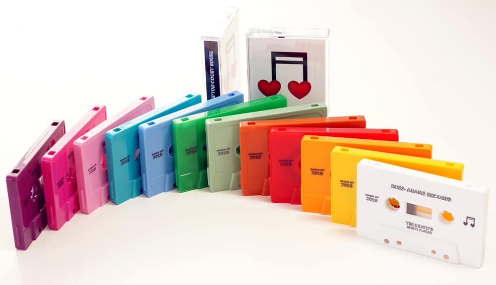 A rainbow selection of 12 different cassette shell colours with an on-body black print