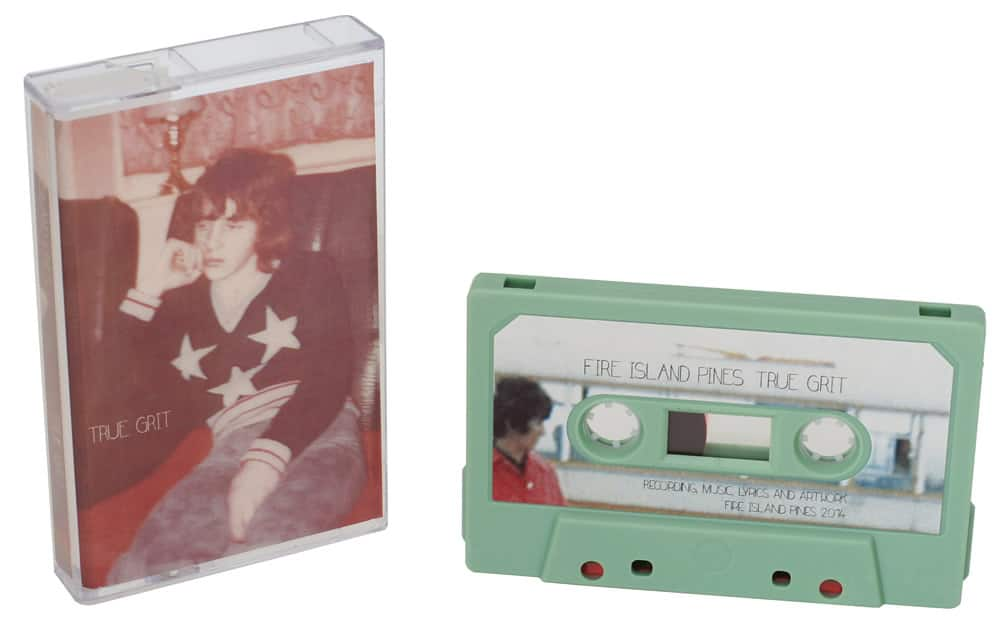 A set of sage green cassettes with printed J-card inserts