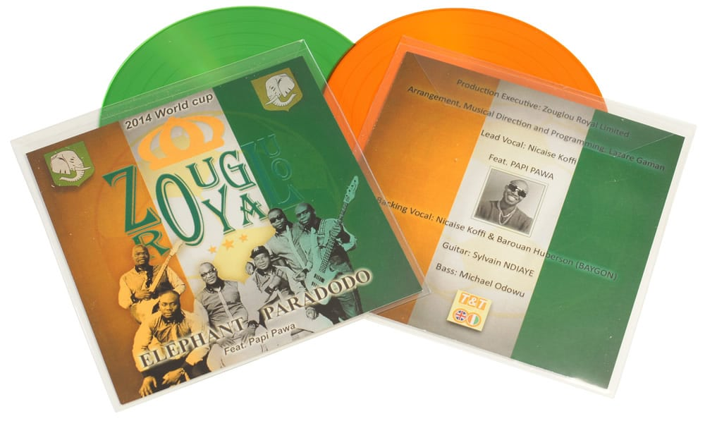 Green and orange vinyl CDs in clear plastic wallets with 2 page inserts