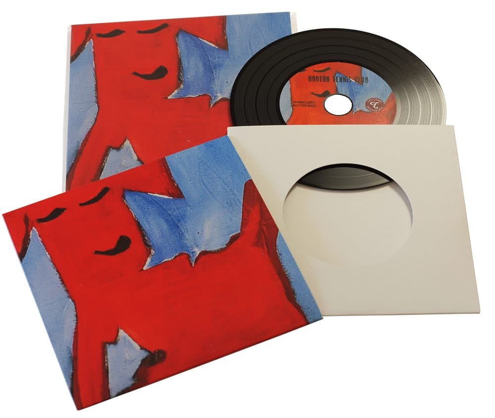 Vinyl CDs in printed card wallets with a larger outer printed wallet and finished with cellophane wrapping