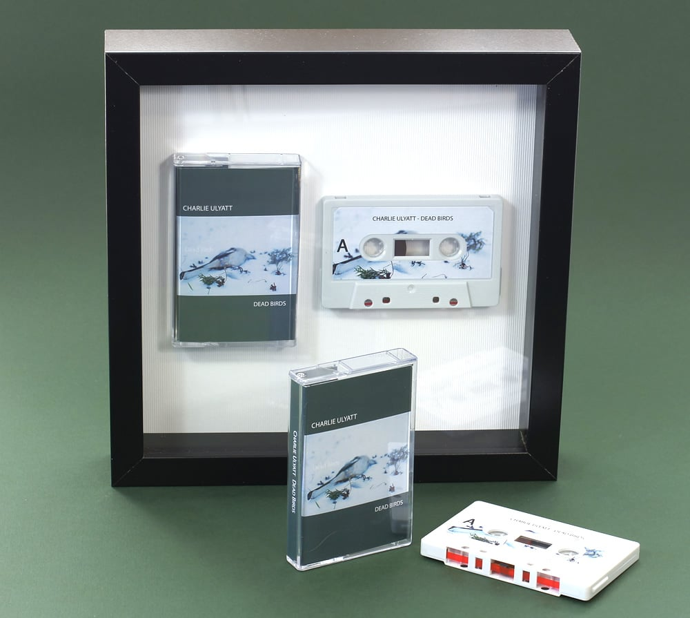 Audio cassette square presentation frame with grey stickered cassette shell and printed cassette case
