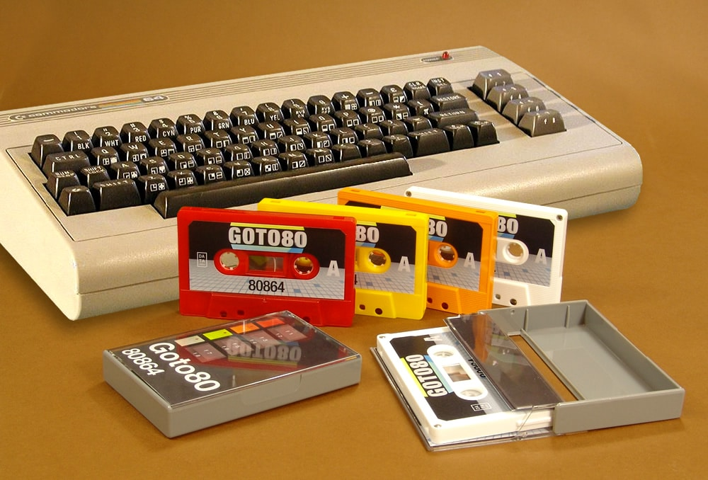 An interesting set of four different colour cassettes in grey cases with audio generated on a Commodore 64 and Roland TR-808 composer