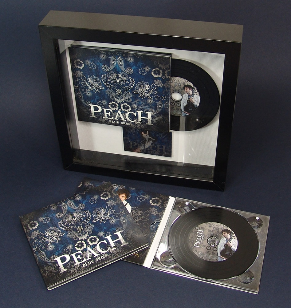 CD digipak in a black presentation frame with printed metal plaque