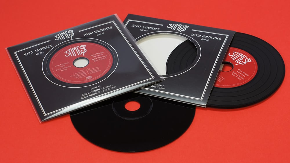 Black vinyl CDs in record-style wallets with fantastic red and black artwork