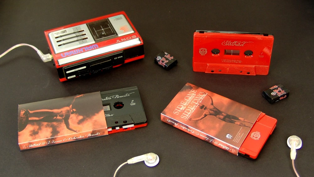 Red and black sandwich cassettes with silver on-body printing and packed in full colour printed O-cards