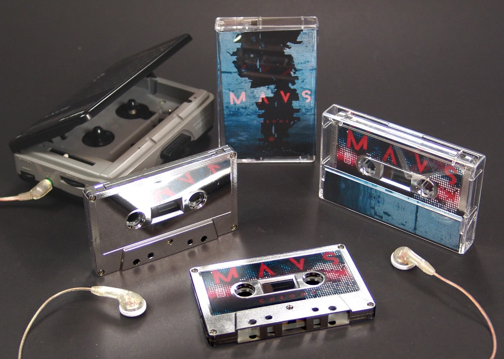 Mirror silver cassettes with a full colour sticker on one side and the other left unprinted to leave a mirror finish