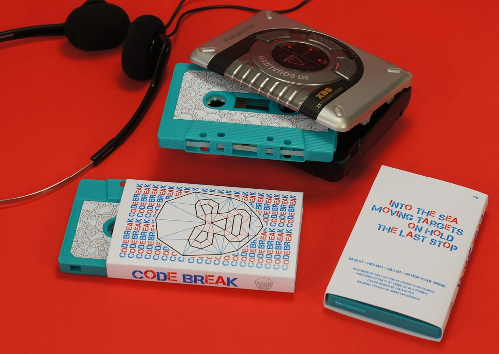 A turquoise cassette with sticker printing in O-cards