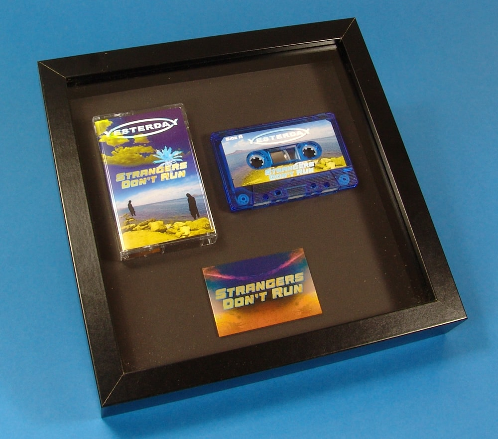 Presentation frame with blue transparent cassette and printed metal plaque