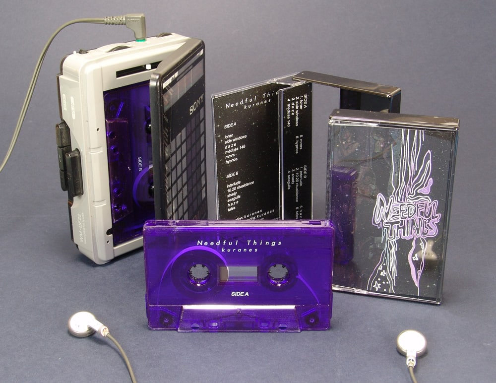 Transparent purple cassettes with white on-body printing and packed in black-back cases
