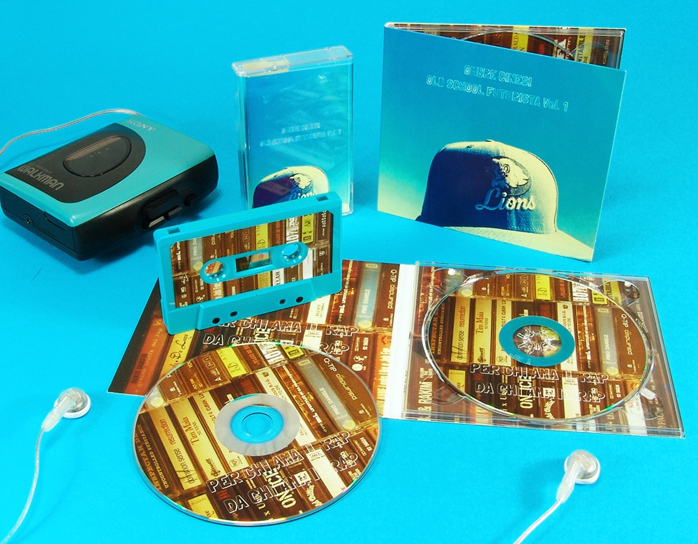 A matching set of four page CD digipaks and turquoise cassette tapes