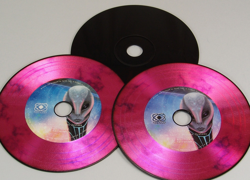 Black based CDs with a full colour on-body print and vinyl rings added on top