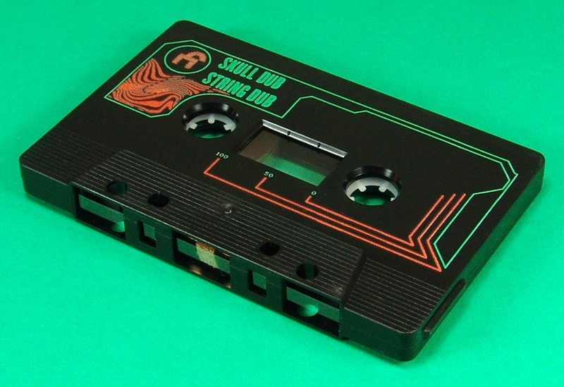 Black cassettes with green and orange on-body printing