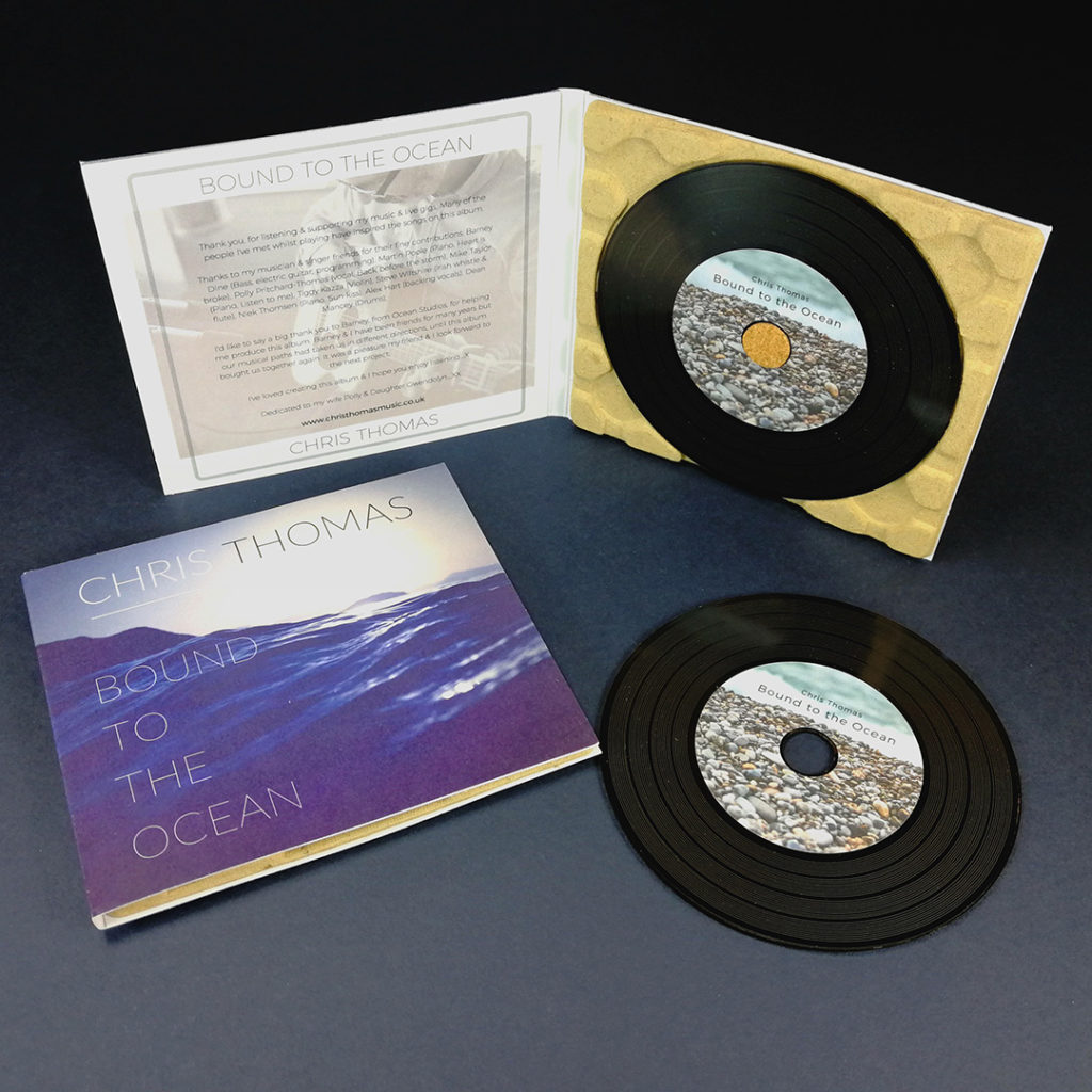 Vinyl CDs in a 100% recycled eco-digipak