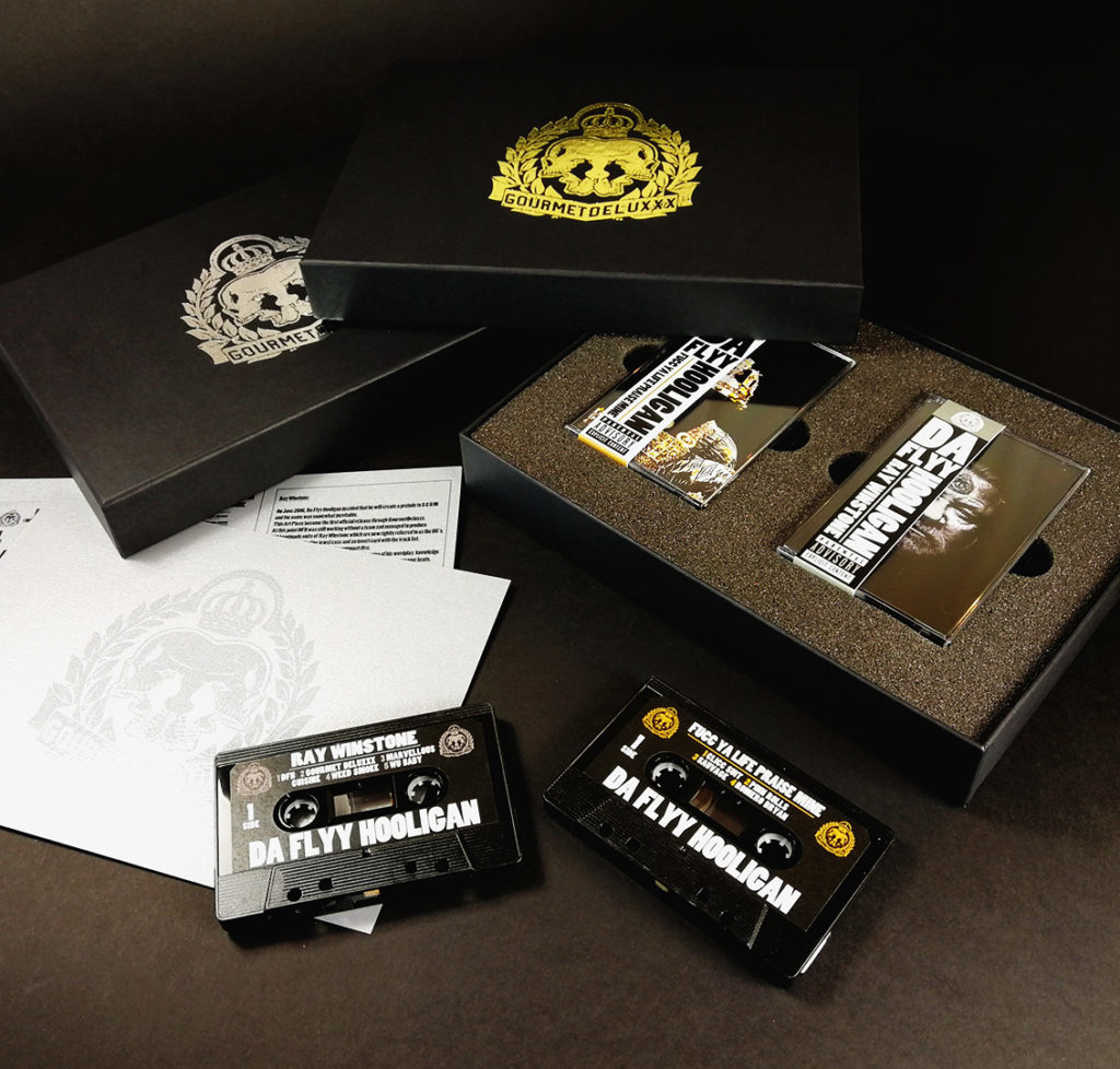 Double cassette tape boxset with obi strips on the tapes, packed in boxes with gold and silver foil lids and with a metallic card insert with spot gloss UV print