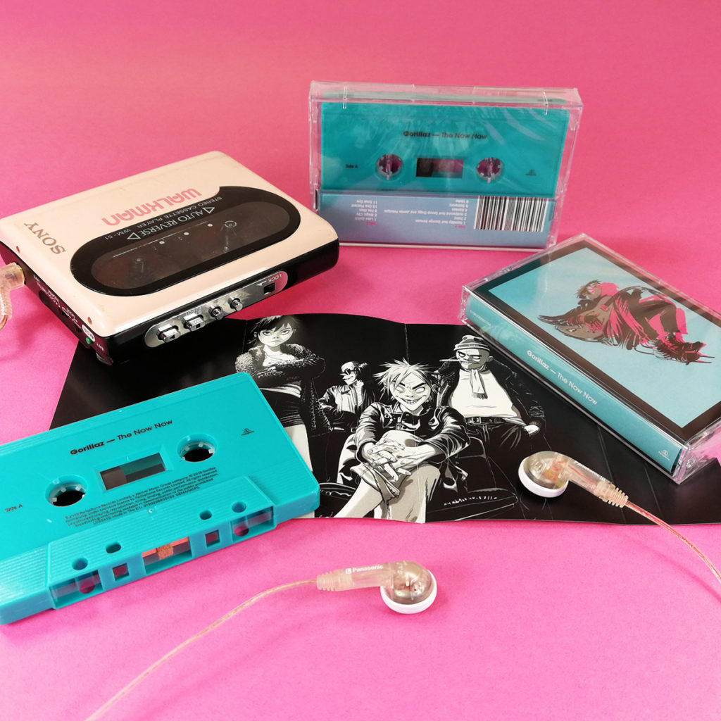 Turquoise cassette tapes with on-body UV LED printing and J-cards with two extra panels